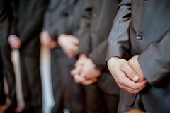 Males Standing in Line. Focus on Hands. Males Standing in Line. Focus on Hands Royalty Free Stock Photos