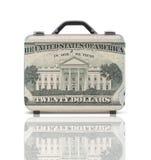 Maleta del negocio para el viaje con la reflexión y 20 dólares de nota Imágenes de archivo libres de regalías