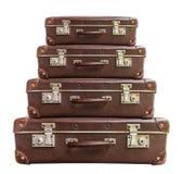Maleta marrón de cuatro vintages en el fondo blanco Foto de archivo libre de regalías