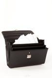Maleta negra en un fondo aislado blanco Fotografía de archivo libre de regalías