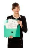Maleta verde con los contratos Fotografía de archivo libre de regalías