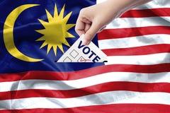 Malezja wybór powszechny pojęcie zamknięty zamknięta ręka obrazy royalty free