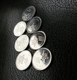 Malezyjczyk monety na Czarnej skórze Obraz Royalty Free