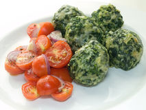Malfatti with tomatoes Royalty Free Stock Photo