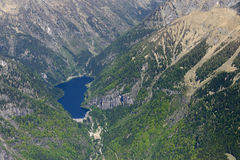 Malga Boazzo mountain lake, Brescia, Italy. Aerial shot, from a small plane, of Malga Boazzo dam and lake, shot on a bright springtime day in Trento mountains Royalty Free Stock Photography