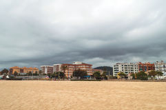 Malgrat de Mar Costa Brava Spain. Beach in Malgrat de Mar Costa Brava Spain. Nasty weather with clouds in sky Stock Images