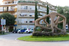 Malgrat de Mar, Spain, August 2018. The central square of the city with an abstract sculpture. Urban residential buildings with balconies in modern style royalty free stock photo