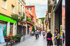 Malgrat de Mar, Spain - July 8, 2014: Old cozy street in spanish town in summer, province of Barcelona, Catalonia. Traditional mediterranean architecture Royalty Free Stock Photo