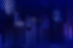 A malha de aço preta e a iluminação azul abstraem o fundo Imagem de Stock Royalty Free