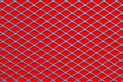 Malha no vermelho imagem de stock