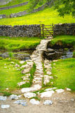 Malham Beck and Clapper Bridge, Malham, Yorkshire Dales, North Yorkshire, England Stock Image