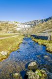 Malham Beck and Cove, Yorkshire England. Malham Beck and Cove in North Yorkshire, England. Stream feeds into the River Aire Royalty Free Stock Image