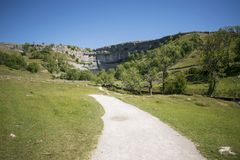 Malham Cove Yorkshire Dales National Park Tourist Attraction. Malham Cove is a limestone formation in Yorkshire Dales National Park, England. The large, curved Royalty Free Stock Photos