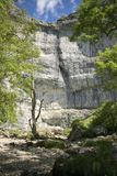 Malham Cove Yorkshire Dales National Park Tourist Attraction. Malham Cove is a limestone formation in Yorkshire Dales National Park, England. The large, curved Stock Images