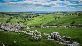 Malham Cove Limestone Pavement. Malham Cove is a natural limestone formation 1 km north of the village of Malham, North Yorkshire, England Stock Image