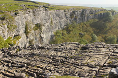 Malham Cove and Limestone Pavement. A wide shot of Malham Cove and limestone pavement natural phenomenon Royalty Free Stock Photography