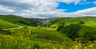 Malham Cove. Is a natural limestone formation 1 km north of the village of Malham, North Yorkshire, England Stock Image