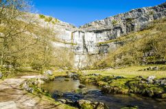 Malham Cove, North Yorkshire, England. Limestone cliffs of Malham Cove in North Yorkshire, England on sunny day Stock Photo