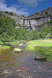 Malham cove. In Malham taken from ground level with river in view Stock Photo