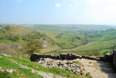 Malham Cove (UK). Stone road captured from the heights of Malham Cove (Yorkshire Dales National Park, UK) leading to a breathtaking landscape Royalty Free Stock Photography