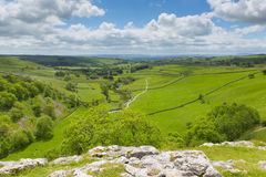 Malham Cove view from walk to top of the tourist attraction in Yorkshire Dales National Park UK. Yorkshire Dales view from Malham Cove UK in summer with blue sky Royalty Free Stock Photography