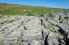 Malham Cove, Yorkshire Dales, England. The limestone cliffs and pavement of Malham Cove in the Yorkshire Dales, England, UK Stock Image
