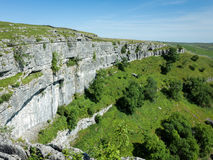 Malham Cove, Yorkshire Dales, England. The limestone cliffs of Malham Cove in the Yorkshire Dales, England, UK Royalty Free Stock Images