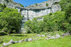 Malham Cove, Yorkshire Dales, England. The limestone cliffs of Malham Cove in the Yorkshire Dales, England, UK Stock Photography