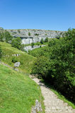 Malham Cove, Yorkshire Dales, England. Walking path leading to the limestone cliffs of Malham Cove in the Yorkshire Dales, England, UK Royalty Free Stock Photo