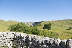 Malham Cove Yorkshire Dales National Park Tourist Attraction. Malham Cove is a limestone formation in Yorkshire Dales National Park, England. The large, curved Royalty Free Stock Photo