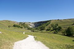 Malham Cove Yorkshire Dales National Park Tourist Attraction. Malham Cove is a limestone formation in Yorkshire Dales National Park, England. The large, curved Royalty Free Stock Image