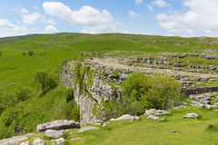 Malham Cove Yorkshire Dales National Park UK rocky top of the cliff at the popular tourist attraction. Malham Cove Yorkshire Dales National Park UK the rocky top Royalty Free Stock Photography