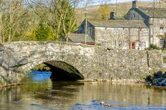 Malham village in North Yorkshire. Stone bridge over a river in Malham village, Craven, Yorkshire, England Royalty Free Stock Photo