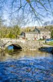 Malham village in North Yorkshire. Stone bridge over a river in Malham village, Craven, orth Yorkshire, England Royalty Free Stock Photo