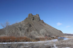 Malheur Butte at winter. Malheur Butte from the south side with the Malheur River in the foreground Royalty Free Stock Photography