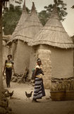 Mali, Africa - Dogon village and typical mud buildings. Ansongo, Mali, Africa - January 28, 1992: Dogon village and typical mud buildings with toguna and barns Royalty Free Stock Images