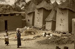 Mali, Africa - Dogon village and typical mud buildings. Ansongo, Mali, Africa - January 28, 1992: Dogon village and typical mud buildings with toguna and barns Stock Photo