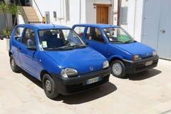 Mali błękitni Fiats Zdjęcia Royalty Free