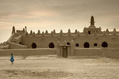Mali, Djenne - January 25, 1992: Mosques built entirely of clay. Mali, Djenne - January 25, 1992:  impressive mosques built entirely of clay in west Africa Royalty Free Stock Image
