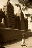 Mali, Djenne - January 25, 1992: Mosques built entirely of clay. Mali, Djenne - January 25, 1992:  impressive mosques built entirely of clay in west Africa Royalty Free Stock Photos