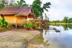 Mali drewniani domy przy dżunglą Obrazy Royalty Free