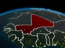 Mali on Earth at night. Space orbit view of Mali highlighted in red on planet Earth at night with visible country borders and city lights. 3D illustration Stock Photos