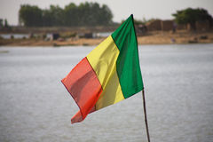 Mali Flag with the Niger. Mali flag floating with the Delta of Niger behind Stock Photos