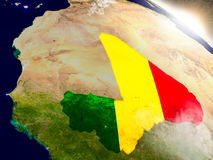 Mali with flag in rising sun Stock Photography