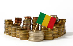 Mali flag with stack of money coins Stock Images