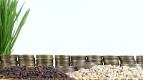 Mali flag waving with stack of money coins and piles of wheat. And rice seeds stock footage
