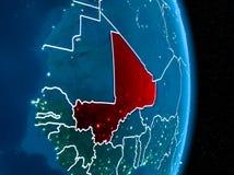 Mali i rött på natten Arkivbilder