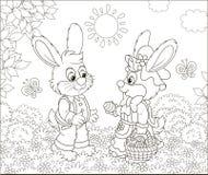 Mali króliki z dekorującym Wielkanocnym koszem fotografia stock