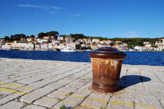 Mali Losinj harbour,Croatia. Old,rusty ship's buoy in Mali Losinj harbour in a sunny summer day with blue sky Royalty Free Stock Photography