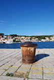 Mali Losinj harbour,Croatia. Old,rusty ship's buoy in Mali Losinj harbour in a sunny summer day with blue sky Royalty Free Stock Photos